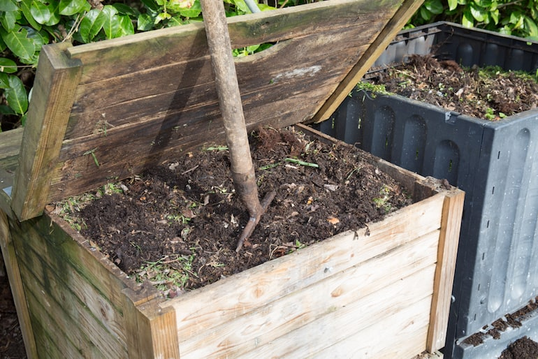 compost bin with garden fork