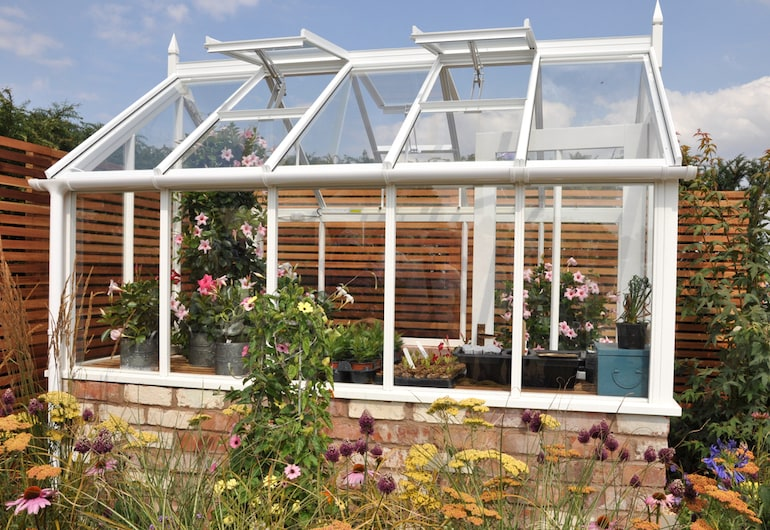 greenhouse with windows and vents open