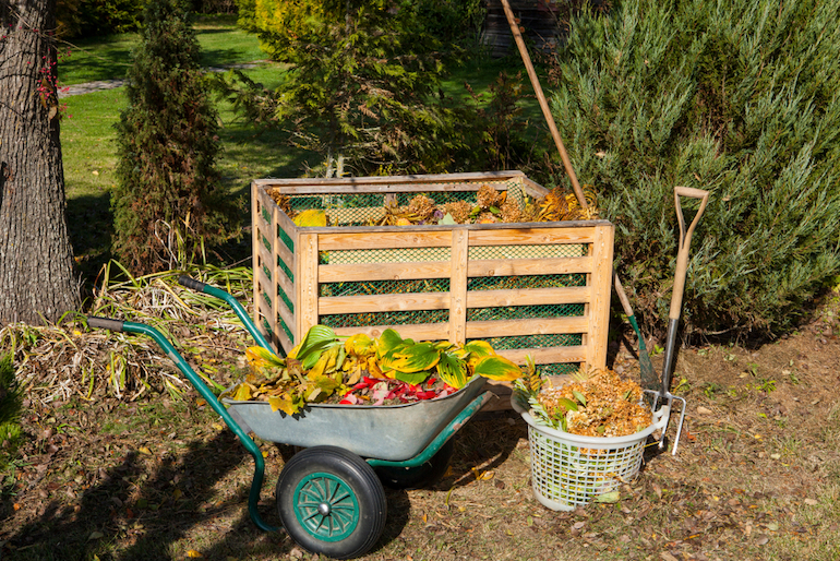 compost and wheelbarrow full of compost