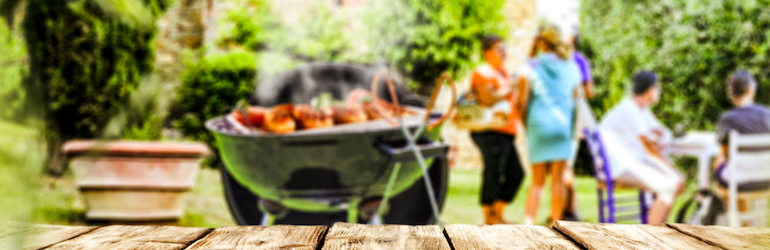 blurred image of a family bbq in the summer