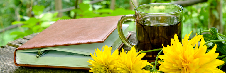 notebook and tea in the garden