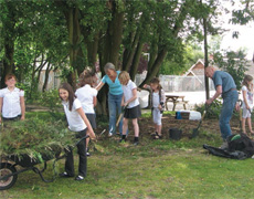 Christine Maclaren and Jack Stuart with some of the after school club, clearing the copse area.