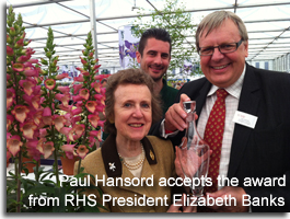 Paul Hansord accepts award from RHS President Elizabeth Banks