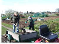 Andrew & his son at the allotment